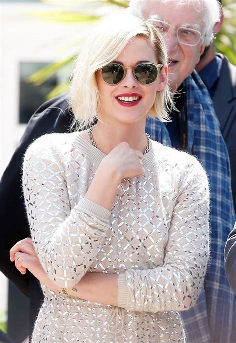 Confident Kristen Stewart plays for the cameras at Cannes